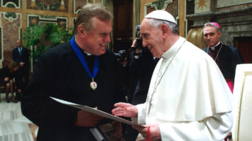 Receiving the 2013 Ratzinger Prize for Theology from Pope Francis